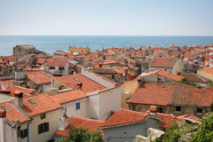Roof tops in little town by the sea Stock Photos