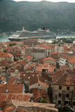 Roof tops of the old town Kotor with ship in background Royalty Free Stock Photography