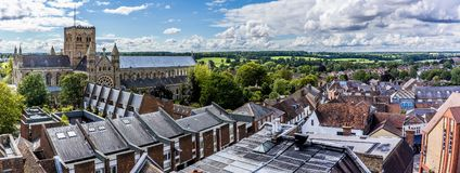 The roof tops of St Albans, UK in summertime. A panorama view across the roof tops of St Albans, UK in summertime stock images
