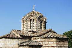 Roof and tower of old orthodox church in Greece. Details from the roof and tower of an old orthodox church in Greece. The walls are made from stone and the roof Stock Photo