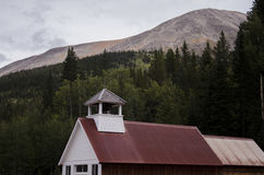 The Roof of the town Hall and Jail in St. Elmo in Colorado with mountains overlooking Royalty Free Stock Images