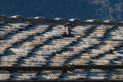 Roof of traditional chalet in European Alps made of stones Stock Images