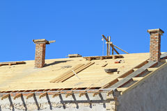 Roof under construction. Carpentry work Stock Photography