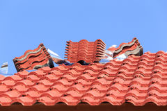 Roof under construction with stacks of roof tiles for home build Royalty Free Stock Photo