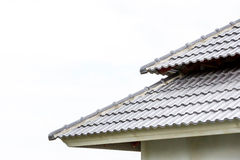 Roof under construction with stacks of roof tiles for home build Royalty Free Stock Photography