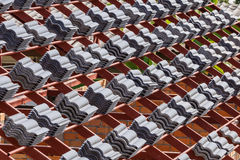 Roof under construction with stacks of roof tiles for home build Stock Image