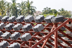 Roof under construction with stacks of roof tiles for home build Stock Photography