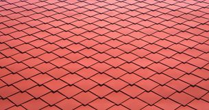 Red tiles roof for background. Close up of metal roof tile stock image
