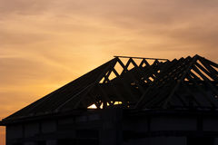 Roof under construction. During sunset Stock Photos