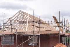 Roof under construction. A roof under construction with trusses and joists royalty free stock image
