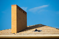 Roof under constructions with lots of tile and yellow brick chimney Royalty Free Stock Photography