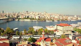 Roof Valide Khan, Galata Bridge and Yeni Cami The New Mosque in Istanbul, Turkey stock footage