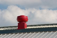 Roof and vent. Red ventilator on rooftop Stock Images