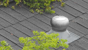 Roof Ventilator spins in the Windy day stock video footage