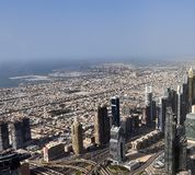 Roof view on Dubai from the 154th floor of the Burj Khalifa royalty free stock photos