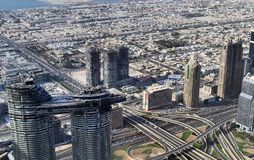 Roof view on Dubai from the 154th floor of the Burj Khalifa stock image