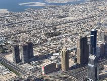 Roof view on Dubai from the 154th floor of the Burj Khalifa royalty free stock image
