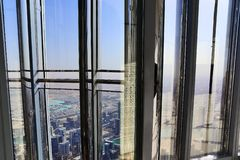 Roof view on Dubai from the 154th floor of the Burj Khalifa royalty free stock photography