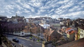 Roof view of fabulous buildings in small European town, amazing cloudy sky above