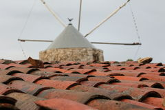 Roof. A roof with a windmill as background in Pedreiras - Porto de Mós - Portugal Royalty Free Stock Photo