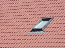 Roof window. Tile roof with window Stock Photography