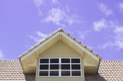 Roof window on blue sky Royalty Free Stock Photo