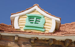 Roof window of fairy tale house in children's park Royalty Free Stock Photos