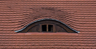 Roof window. Half-round window a the roof stock image