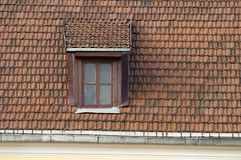 Roof, window, tile. Tile roof with a window on it Stock Photography