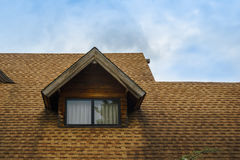 Roof and window of wooden cabin Stock Photography