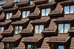 Roof windows. Modern architecture detail - hotel building with windows in the roof Stock Images