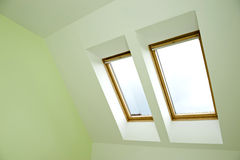 Roof windows. Two roof wooden windows Royalty Free Stock Images