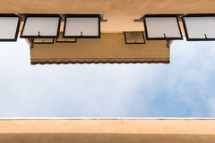 Roof and windows on blu sky background. Ant eye view Stock Photography