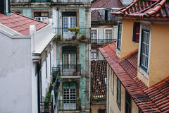 Roof and windows of houses. Old roof and windows of houses royalty free stock image