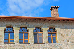The roof and windows of the Monastery in Meteora, Greece stock photography