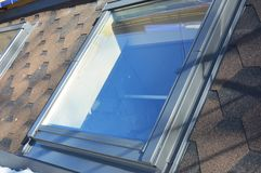 Roof windows and skylights installation with snow in winter. Stock Image