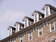 Roof windows stone building Stock Photos