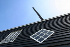 Roof an wing of The woodsaw-mill de Rat in IJlst Stock Images