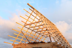 Roof of the wooden house under construction against the sky Royalty Free Stock Photography