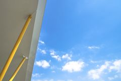 The roof with yellow pillars and blue sky with some cloud. Very suitable for use as background.  stock photography