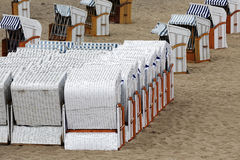 Roofed beach chairs on the beach Stock Photos