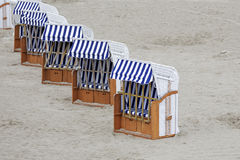 Roofed beach chairs placed in a line Stock Images