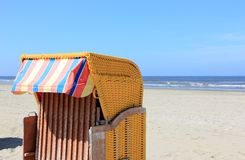 Roofed wicker beach chair. Egmond aan Zee, North Sea, the Netherlands. Stock Photo