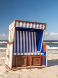 Roofed wicker beach chair Stock Image