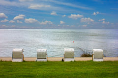 Roofed Wicker Beach Chair. At the Ocean Royalty Free Stock Images