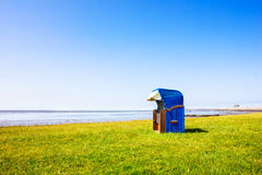 Roofed Wicker Beach Chair. At the Ocean Royalty Free Stock Image