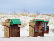 Roofed wicker beach chairs on the beach Royalty Free Stock Photos