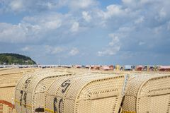 Roofed wicker beach chairs on the beach inTravemünde. Roofed wicker beach chairs on the beach in Travemünde at the Baltic Sea Stock Image