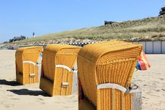 Roofed wicker beach chairs. Egmond aan Zee, North Sea, the Netherlands. Royalty Free Stock Image