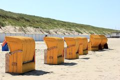 Roofed wicker beach chairs. Egmond aan Zee, North Sea, the Netherlands. Stock Photo
